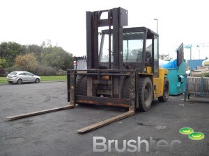 High Capacity Forklifts for unloading new brush machine.