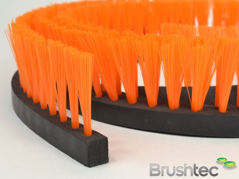 Flexible rubber brush strip